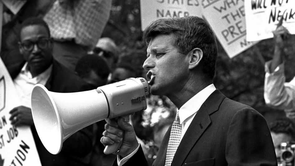 Robert Kennedy addresses demonstrators in front of the Justice Department, 1963.