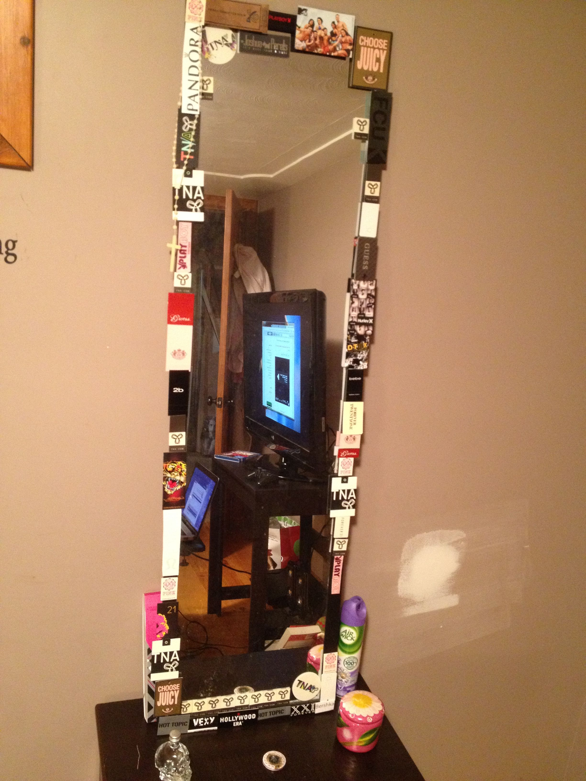 Clothes tags with tape around my mirror on the end table for height !