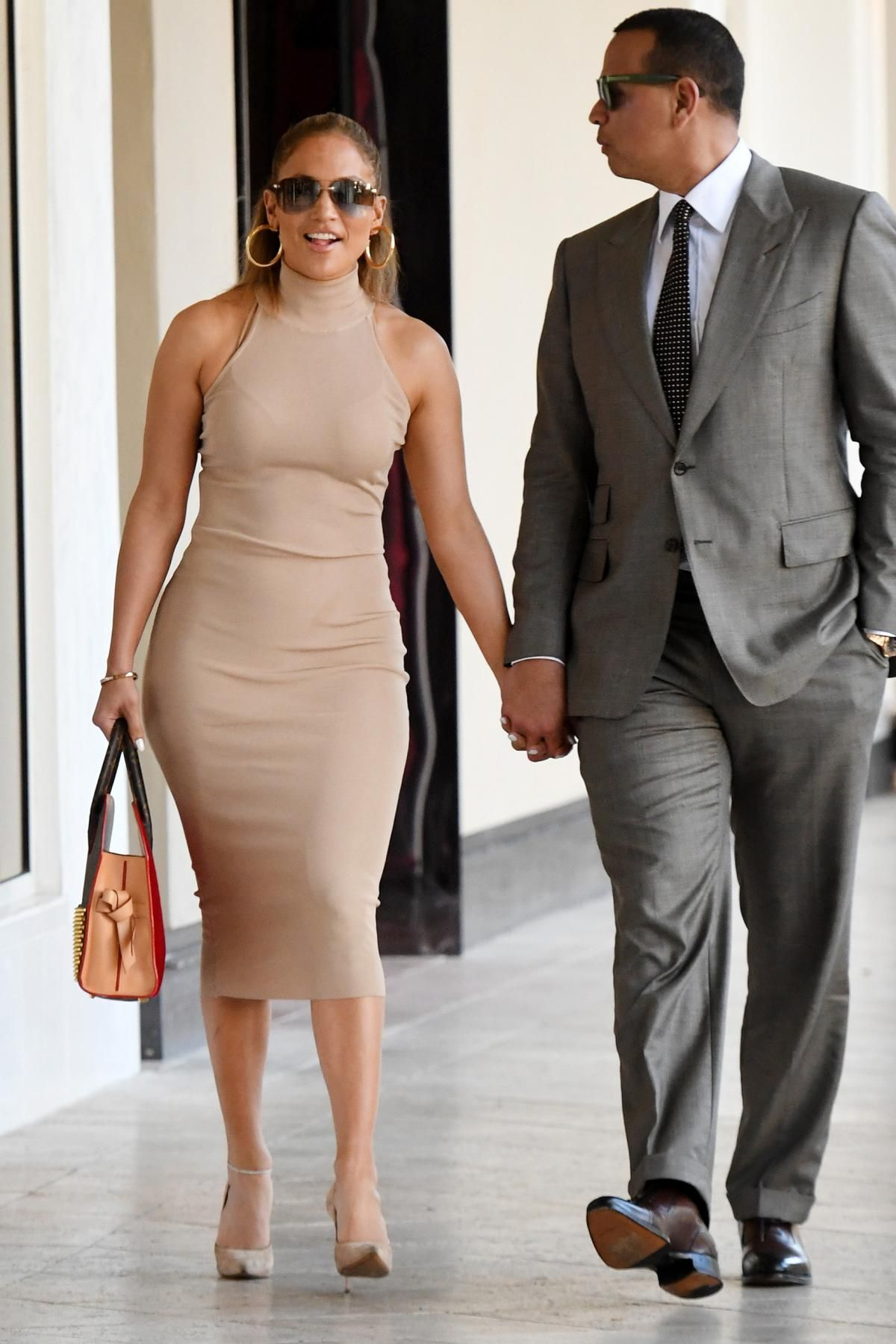 468ca81ea69b Jennifer Lopez is all smiles in her Naked Wardrobe dress