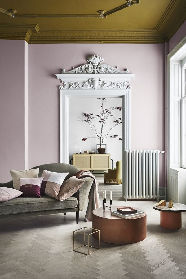 Living room painted Millennial Pink with taupe home deor and a gold ...