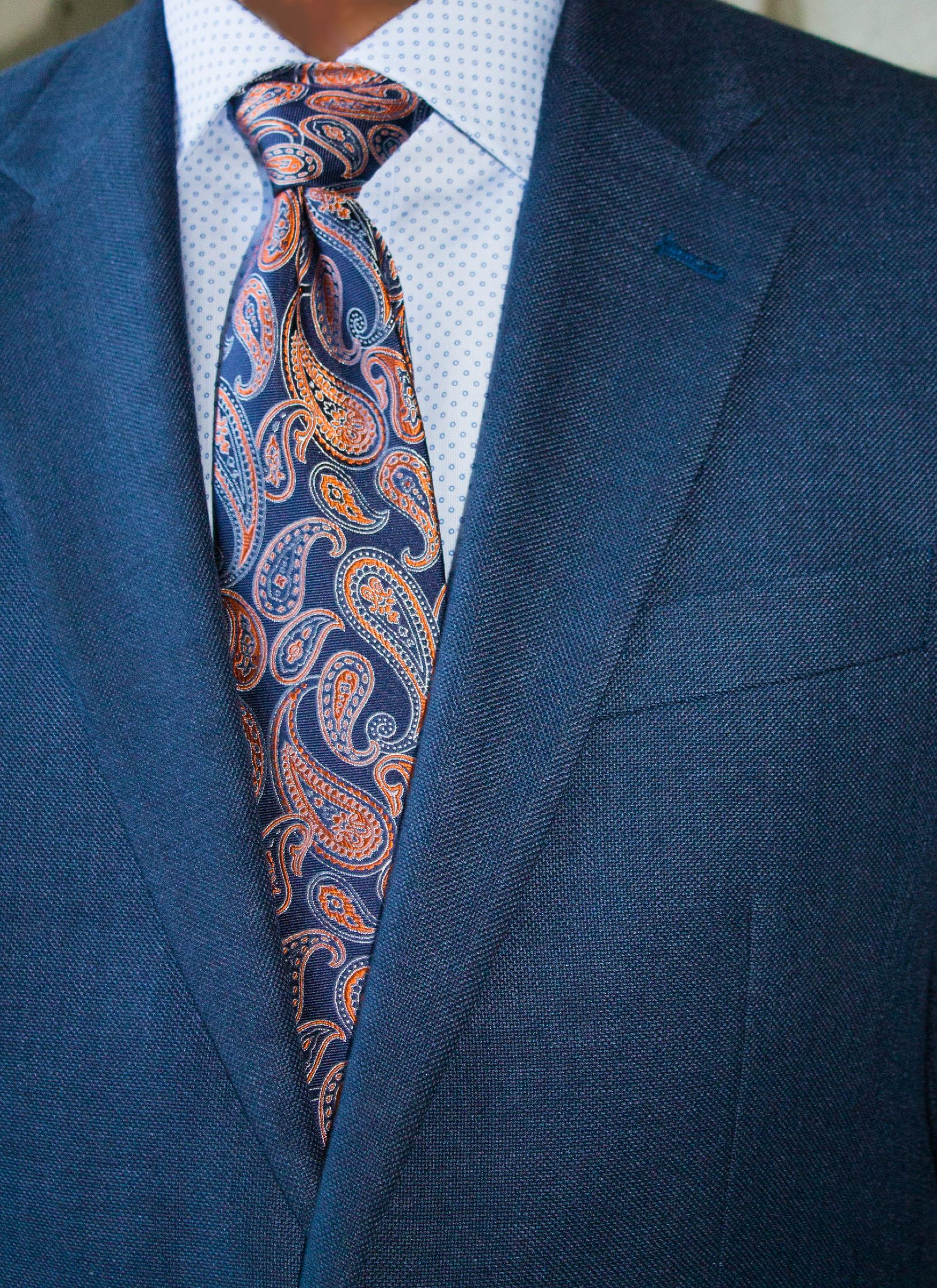 a723445f0d67 Navy suit with paisley tie. The subtle polka dots in this shirt pairs  nicely with the tie.