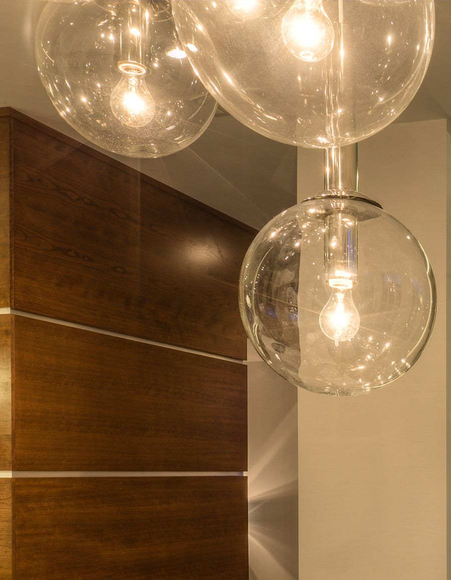 A fixture with multiple large edison bulbs add a vintage aesthetic to your contemporary dining room see in gramercy an atlanta community