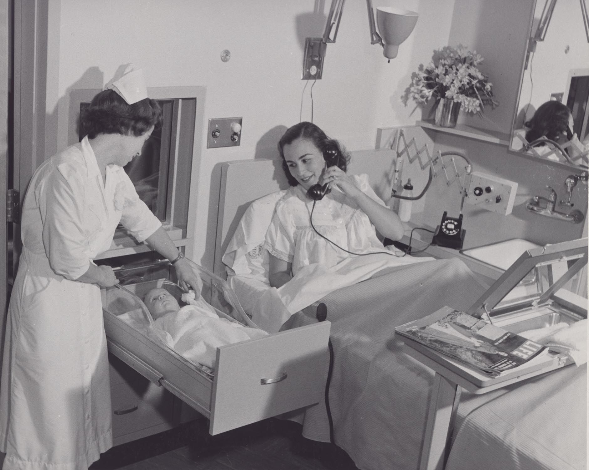 Baby Drawer.   Mother and baby rooming in in Kaiser Permanentes Walnut Creek hospital 1953