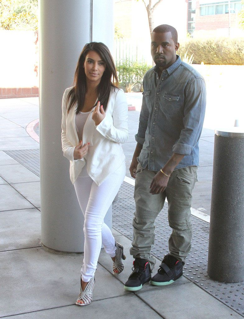 fe9e7e61eb90d Kanye West wearing Nike Air Yeezy 2 Black Solar Red