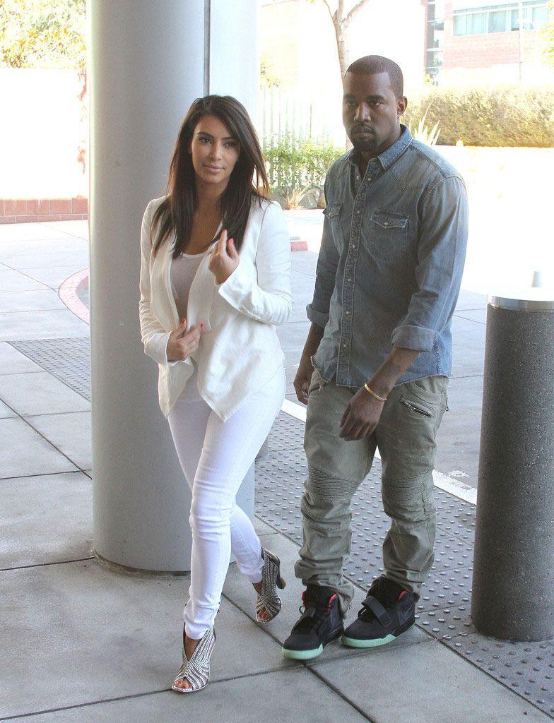 Kanye West wearing Nike Air Yeezy 2 Black Solar Red