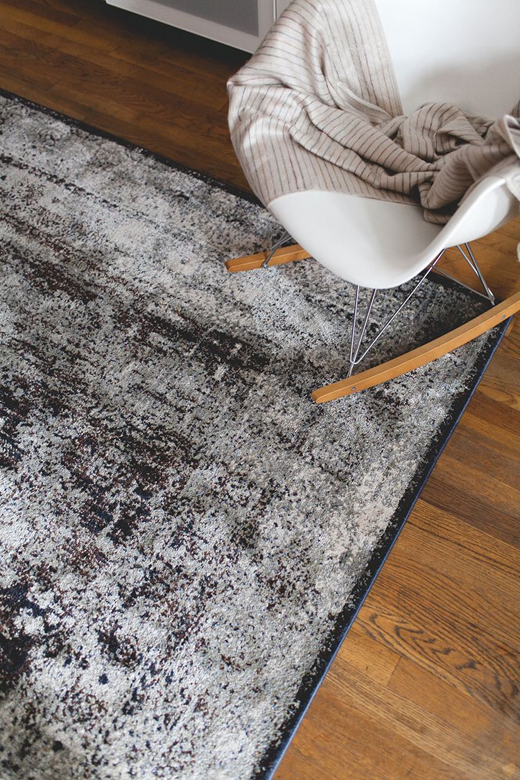 how to use rugs to define spaces in a studio apartment ...