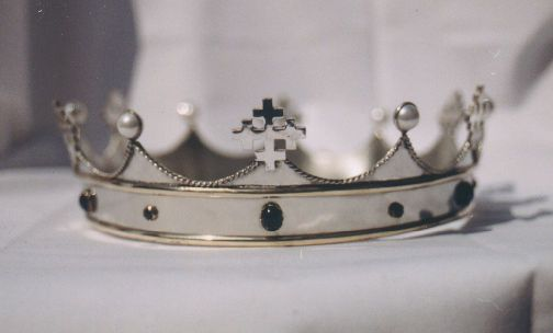 Like the band on the bottom, cabochons. Don't like the crosses or the way the pearls are mounted