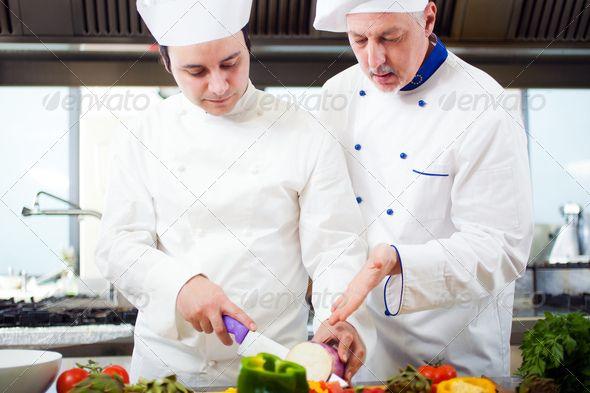 Chefs at work ...  Cooks, chef, chefs, class, cook, cooking, cuisine, dinner, dish, expert, food, fresh, gourmet, kitchen, lunch, male, man, master, mature, people, person, restaurant, school, senior, stage, student, teacher, teaching, team, teamwork, training, two, vegan, vegetarian, workshop