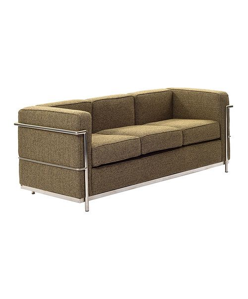 Mid-century modernism meets luxurious comfort in this tastefully retro sofa. With a cozy, welcoming build, this piece offers a relaxing experience while adding an element of classic style to décor. 71'' W x 28'' H x 28' 'DStainless steel / foam / wood / clothImported