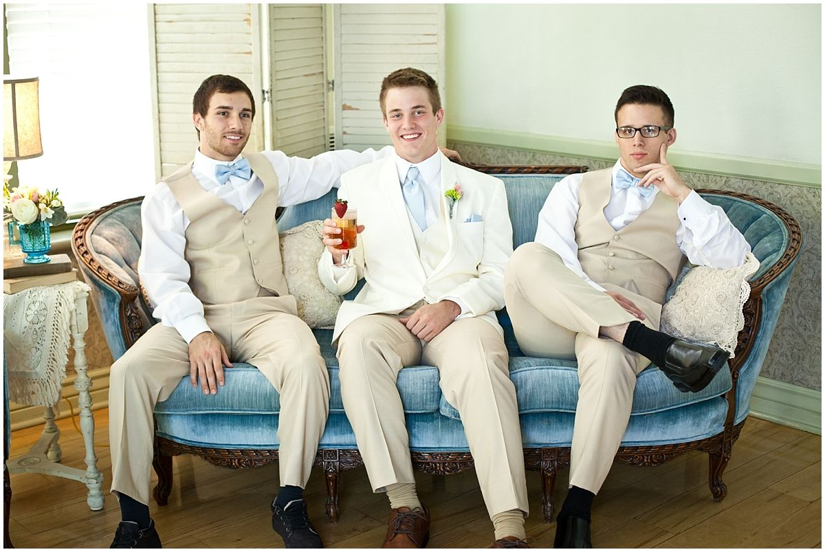 Gatsby Party Styled Shoot Groomsmen on powder blue vintage couch.