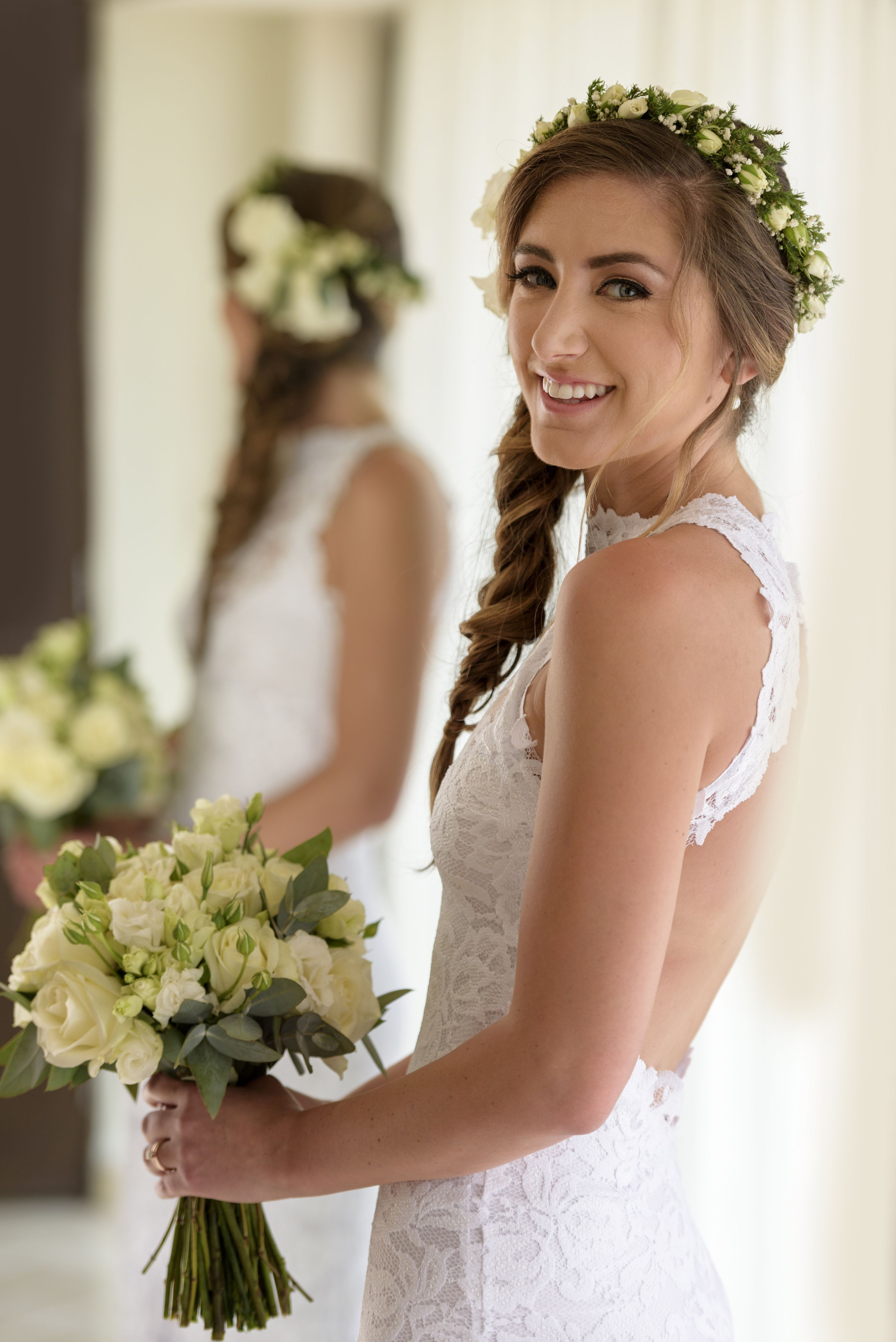 bridal airbrush makeup and a braid romantic hairstyle for