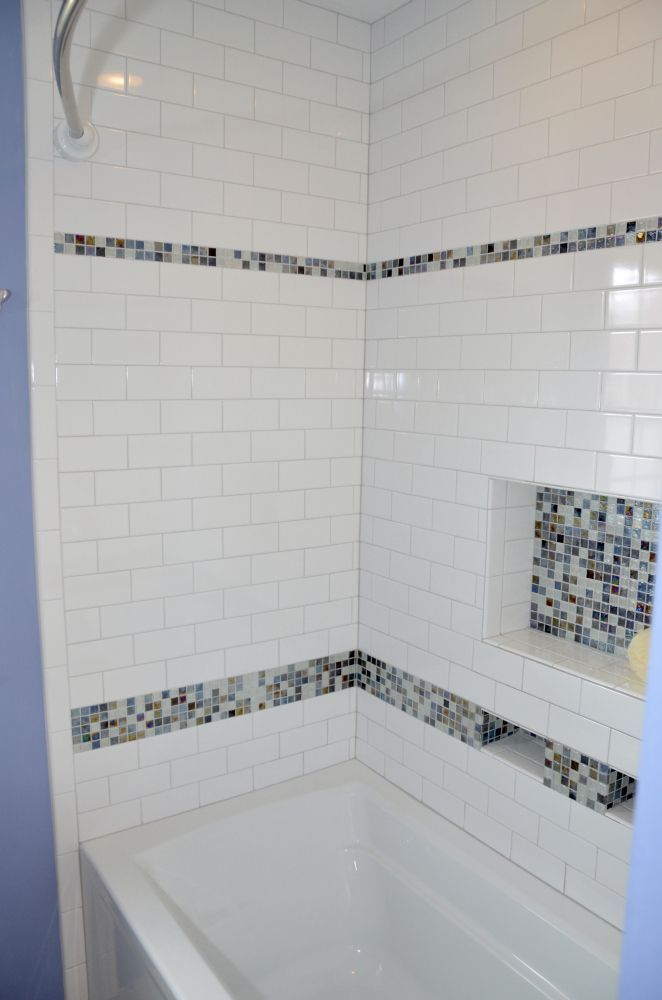 Photo On subway mosaic lower near tub to break up the white tiles Bathroom