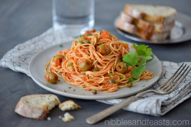Veracruz Style Spaghetti recipe is made with capers and white wine, garnished with fresh cilantro.