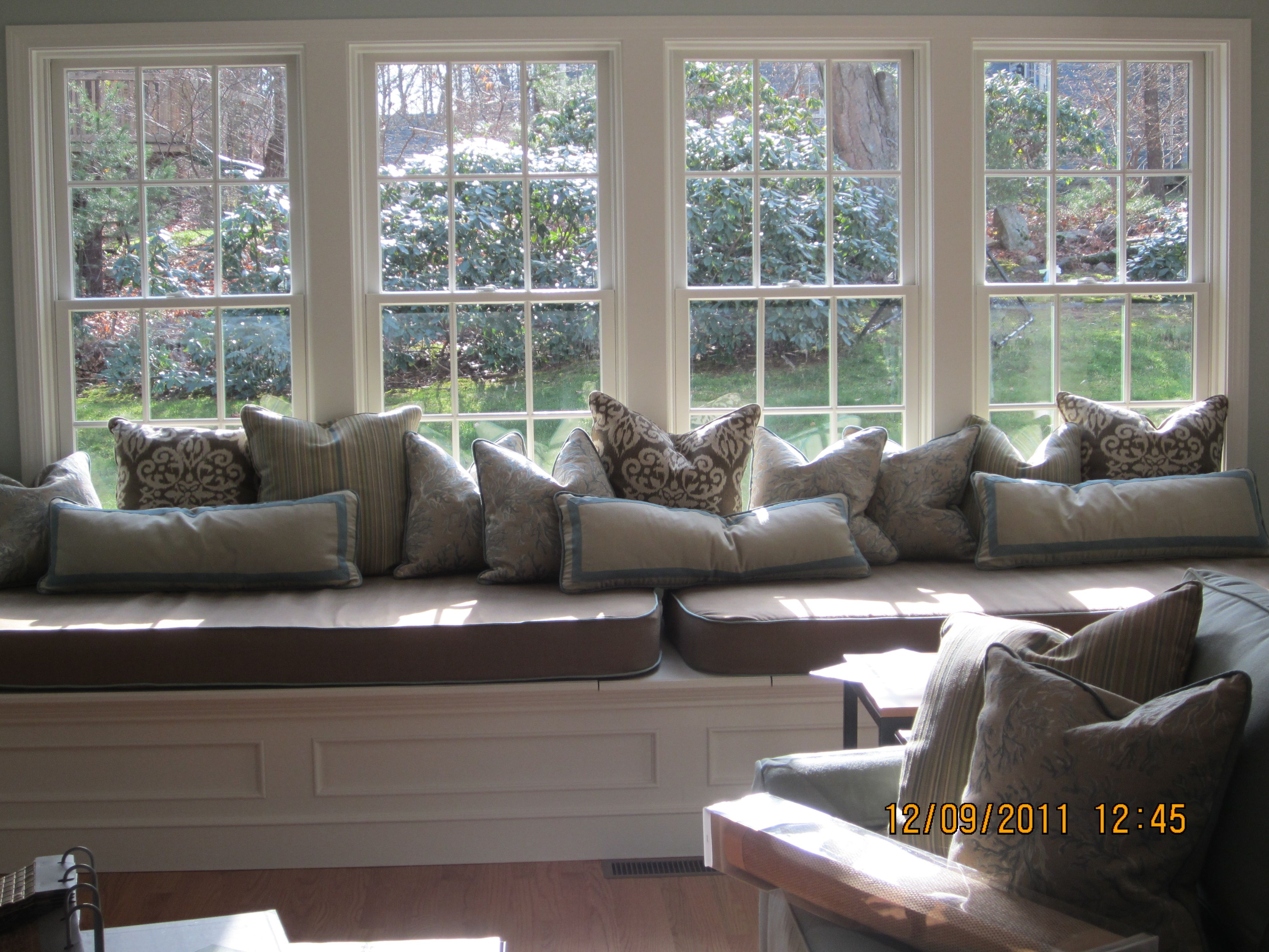 Large Bay Window Seat With Misc Pillows And Cushions Window