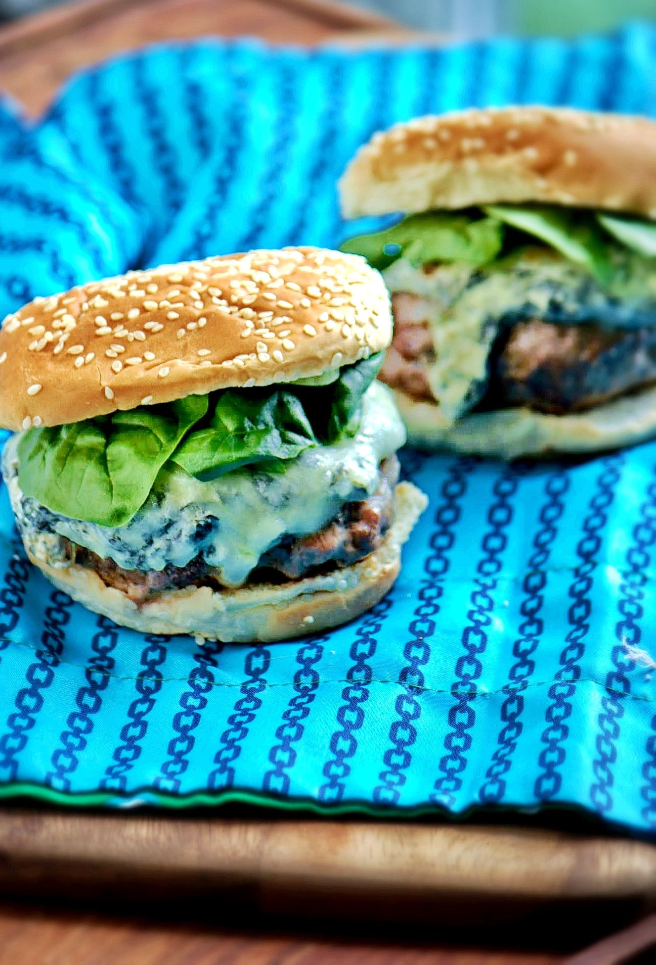 "The ""Sit and Spinach' from Bob's Burgers - all-beef burgers topped with creamy Spinach dip and mozzarella cheese"