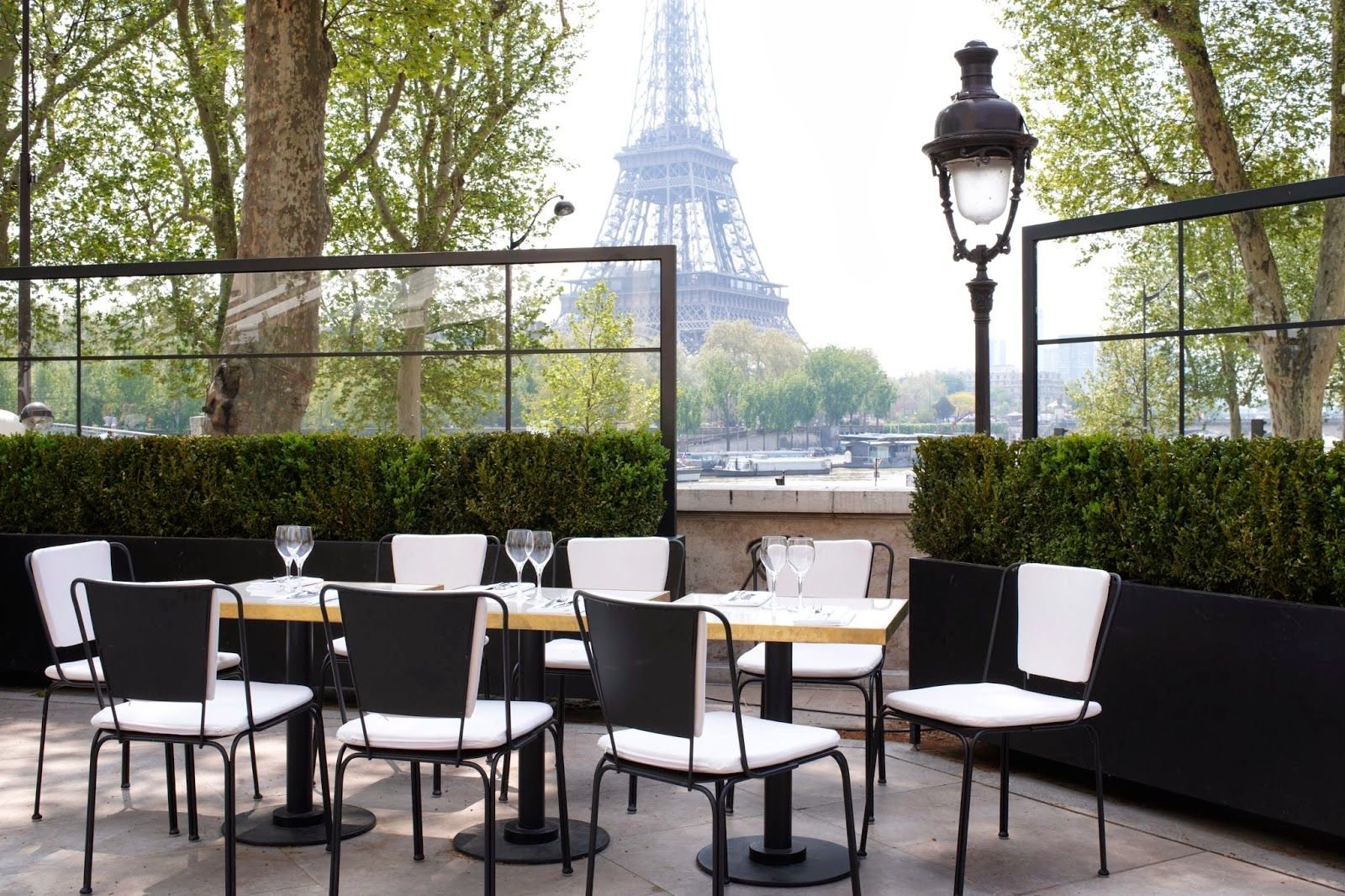 Outdoor cafe in paris with tower in background - Habitually Chic Shares This Terrace Dining Area From Restaurant Monsieur Bleu
