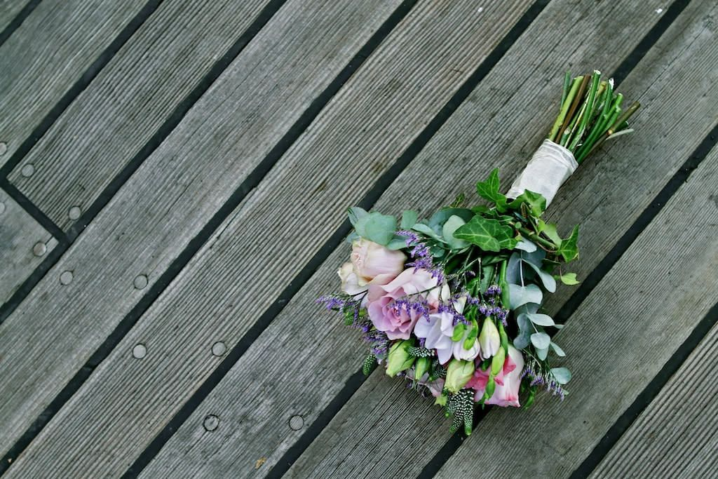 Olivier Burnside Fine Art Reportage Wedding Photographer. Wedding Bouquet on board boat deck