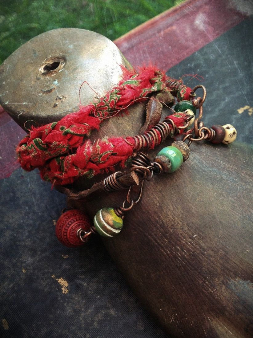 Silk and leather wrap bracelet necklace with African brass and carnelian and beads. $35.00, via Etsy.