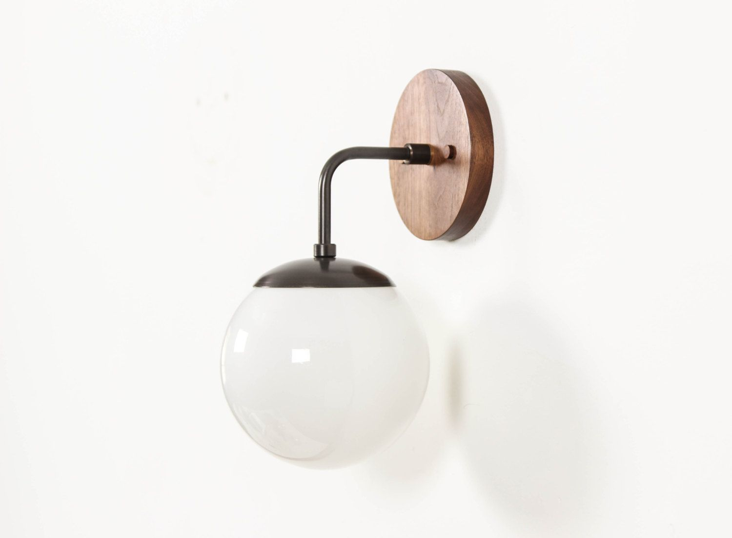 Overview a midcentury inspired handcrafted sconce with wood and