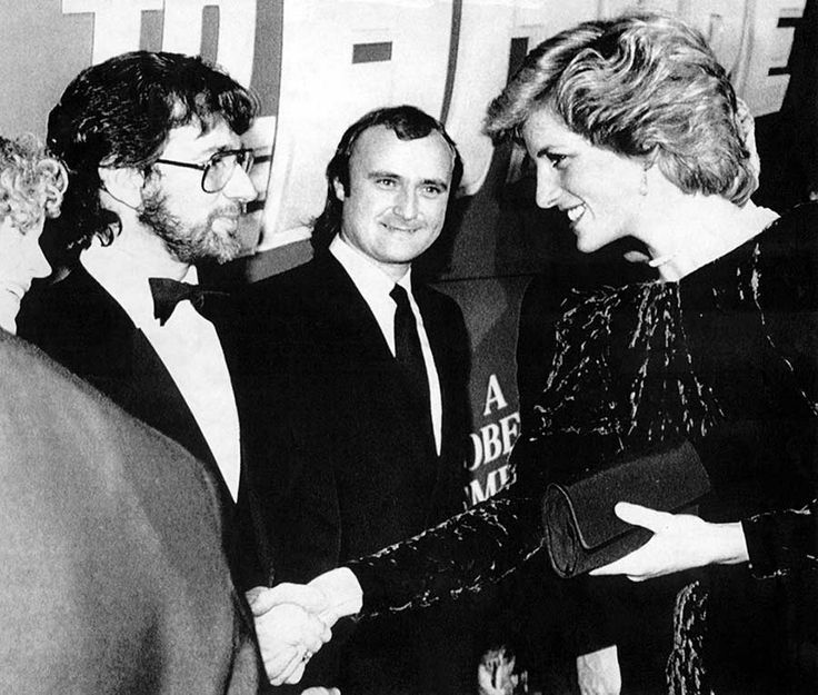 """Steven Spielberg, Phil Collins, and Princess Diana at the UK premiere of """"Back to the Future"""", 1985."""