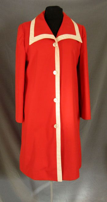 Red 1970's coat with contrasting trim and polka dot lining.