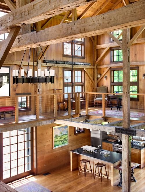 ladder rustic architecture warm Interior Design Living Room Windows country glass furniture conversion Wood Table Couch chairs dining room barn outdoor room natural light living space woodwork open floor plan patio skylights repurposed beams remodeled homey multi level great room