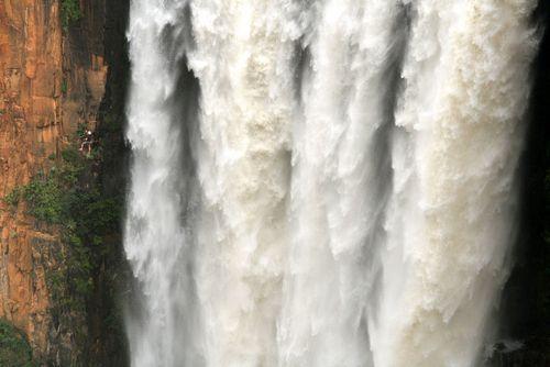 Derick de Beer next to a pumping Howick Falls
