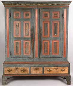 This Lancaster or Berks County, Pennsylvania, circa 1770, pine schrank is painted soft blue, red, and white.