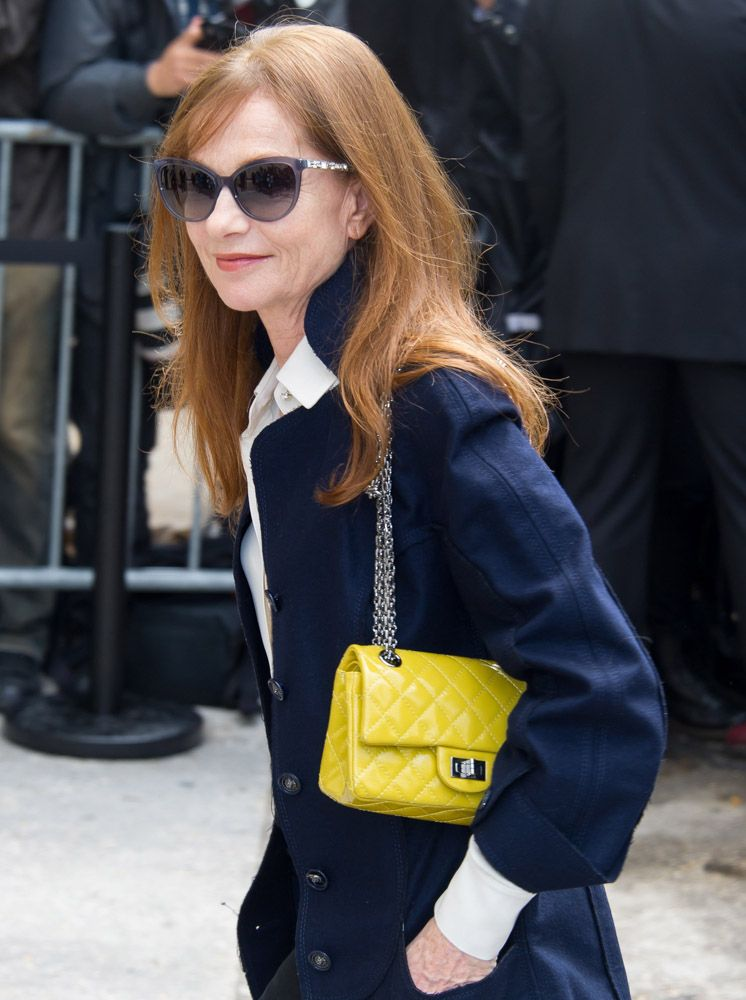 3e53b812071f color combo: navy/white/green-tinged yellow Isabelle Huppert and her Chanel  Reissue 2.55 Flap Bag via The Many Bags of Celebrities at Paris Couture  Week ...