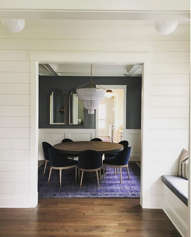 Wainscotting. Millwork. Shiplap hallway opens to dining ...