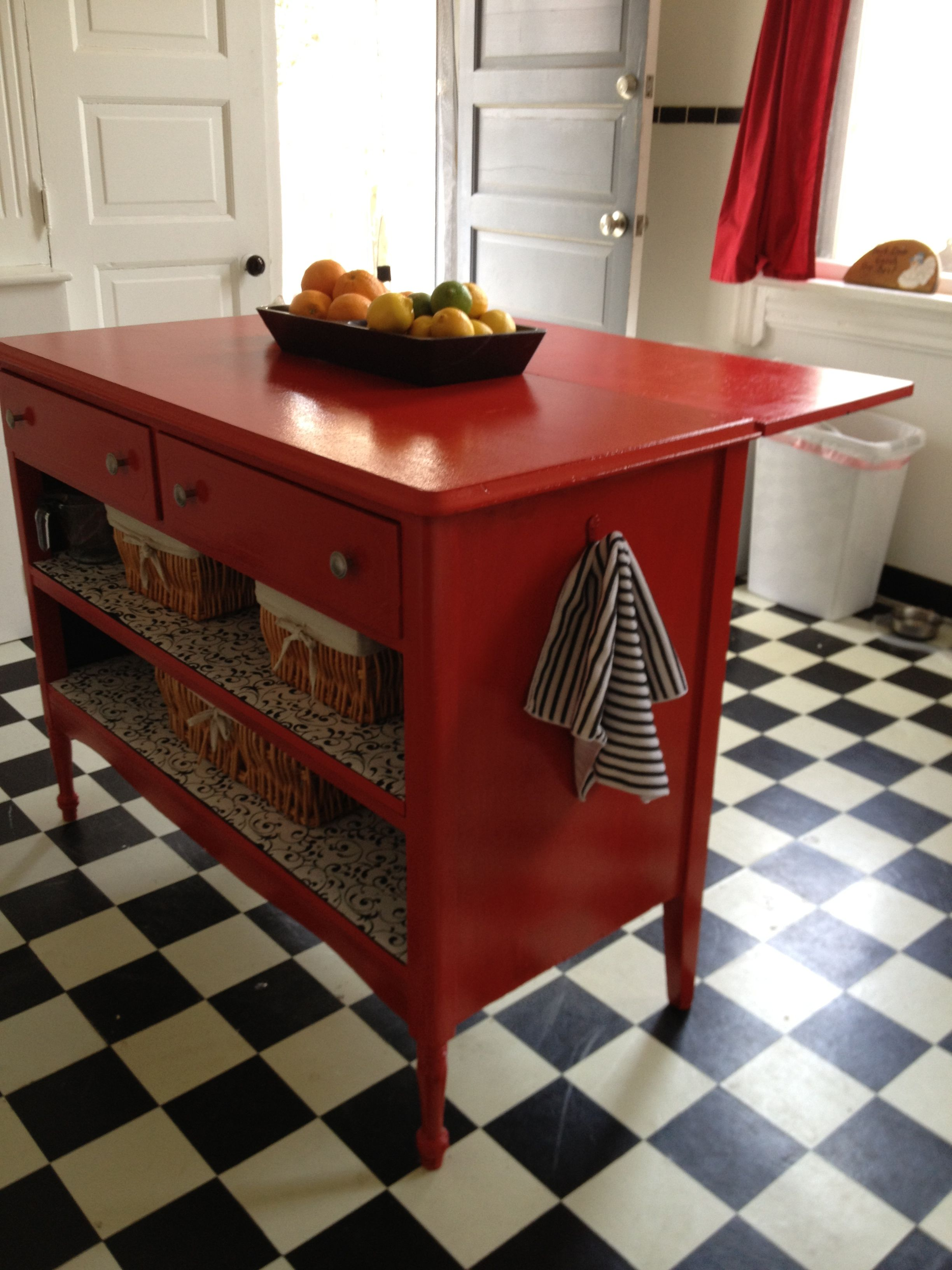 turned an old dresser into a kitchen island. added a leaf by using