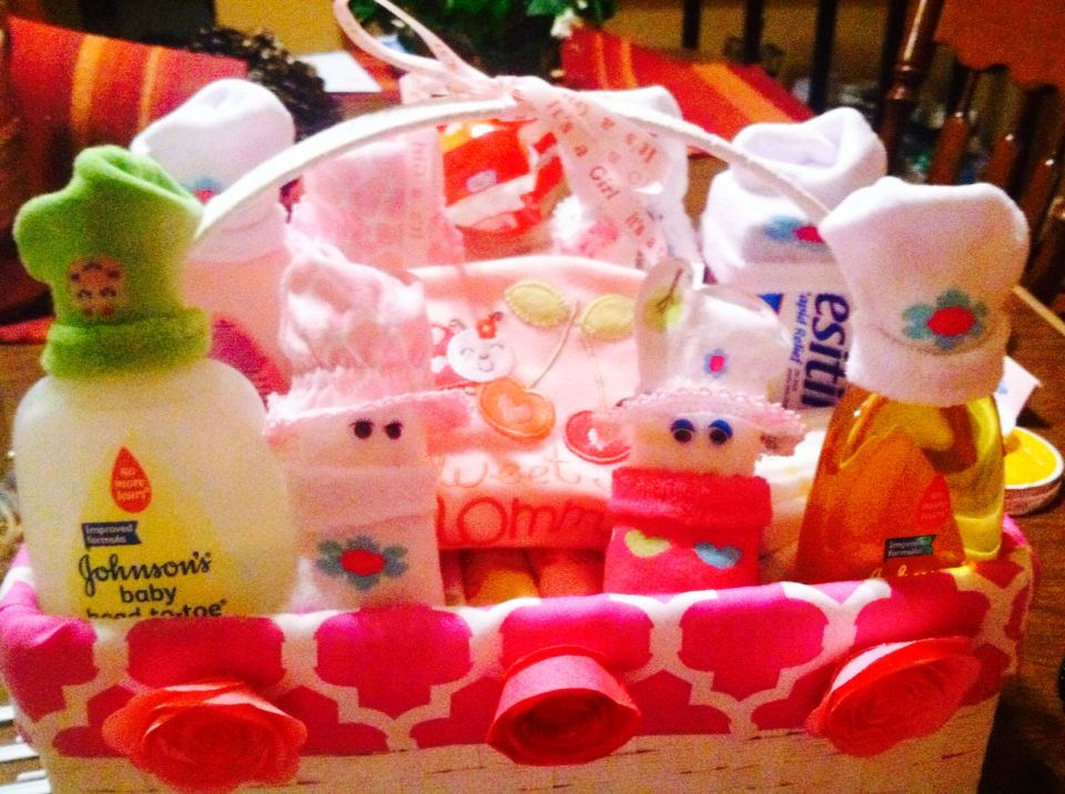 Diaper babies for a baby shower, so simple!  Body is a rolled diaper, hat is baby mitten, swaddle is a sick, hot glue eyes....DONE :)