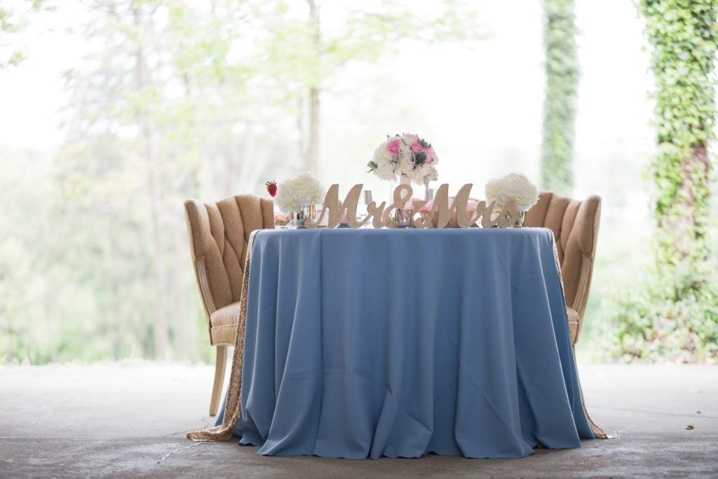 Pastel blue sweetheart table with gold table runner and Mr. & Mrs. table topper at the beautiful Historic Shady Lane - Wedding photographer