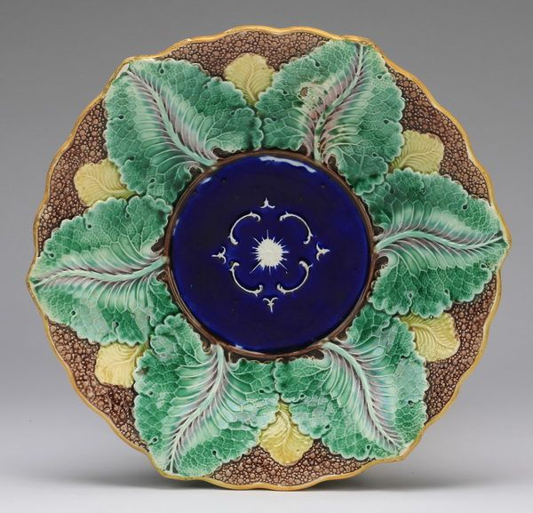 Wedgwood majolica cauliflower bowl, 19th century, the interior with a cobalt center surrounded by a green leaf border on a brown pebbled background, the exterior having green and brown mottled glaze, with impressed Wedgwood mark.