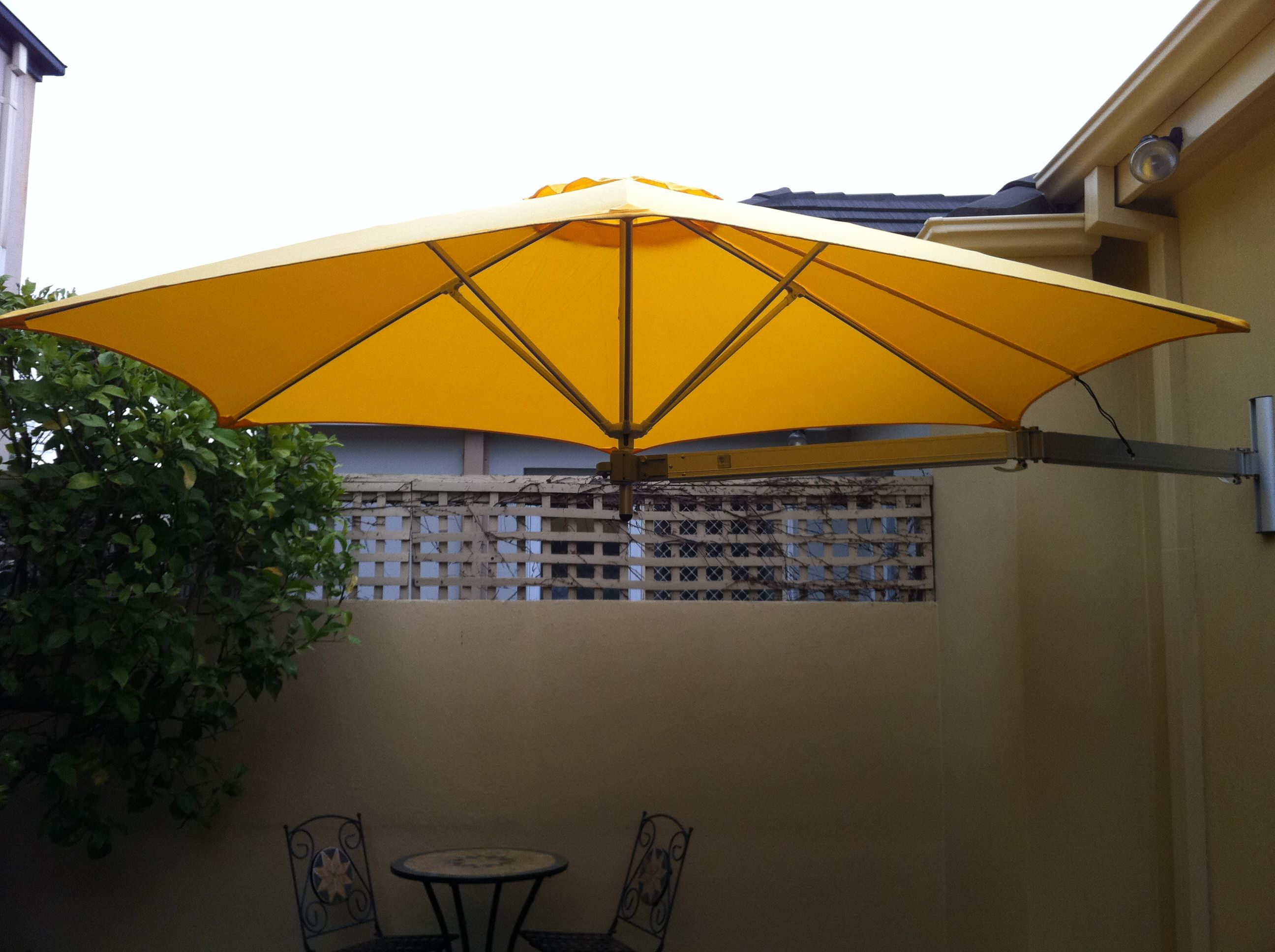 The Best Choice For Shading A Courtyard The Paraflex Wall Mounted Umbrella Shade Umbrellas Umbrella Wall Mount