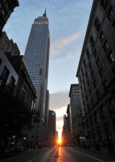 "New York, US: The sun sets along 34th Street aligning with the Manhattan street grid during ""Manhattanhenge"", which happens twice a year"