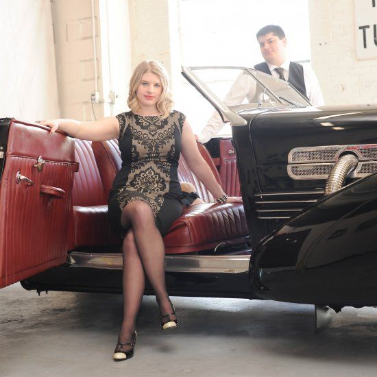 Gatsby inspired 1920s engagement session featuring vintage details and a stunning roadster from JDHowell Photography