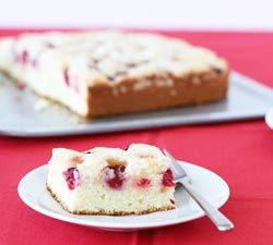 A light, moist and tangy snack cake to take advantage of the spring berries in the market. Of course...