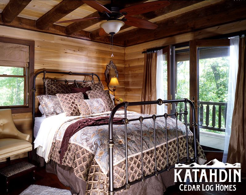 a log home bedroom in the treetops.