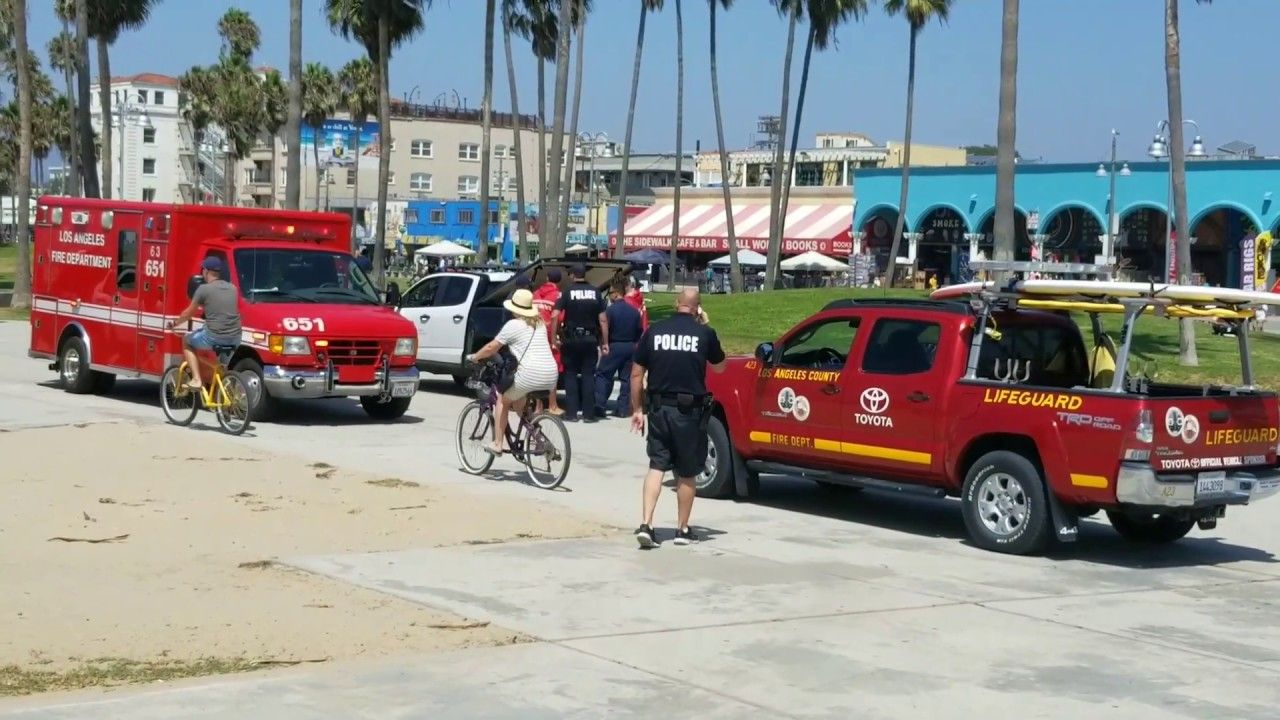 LAPD police car runs over a woman in the sand sunbathing at venice ...