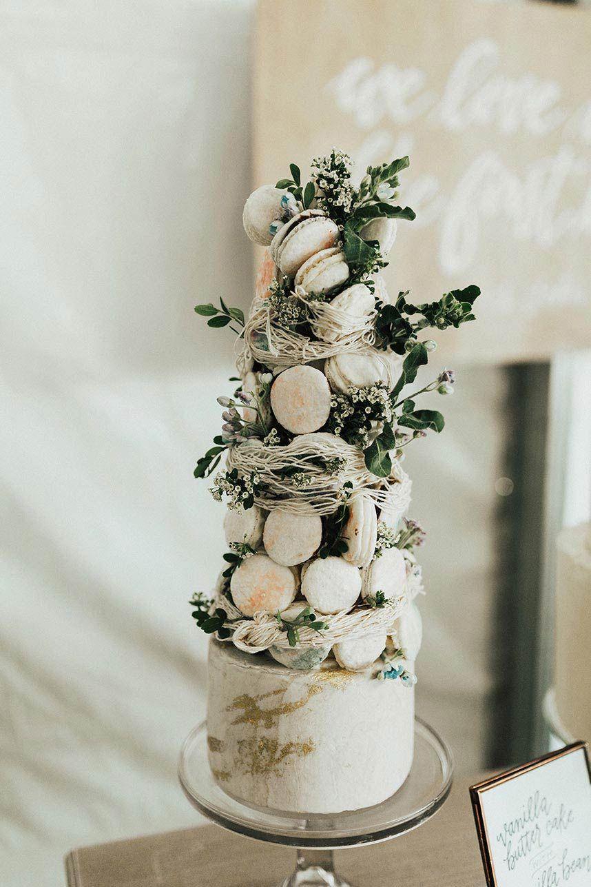 Whimsical backyard wedding cake with macarons weddingcake