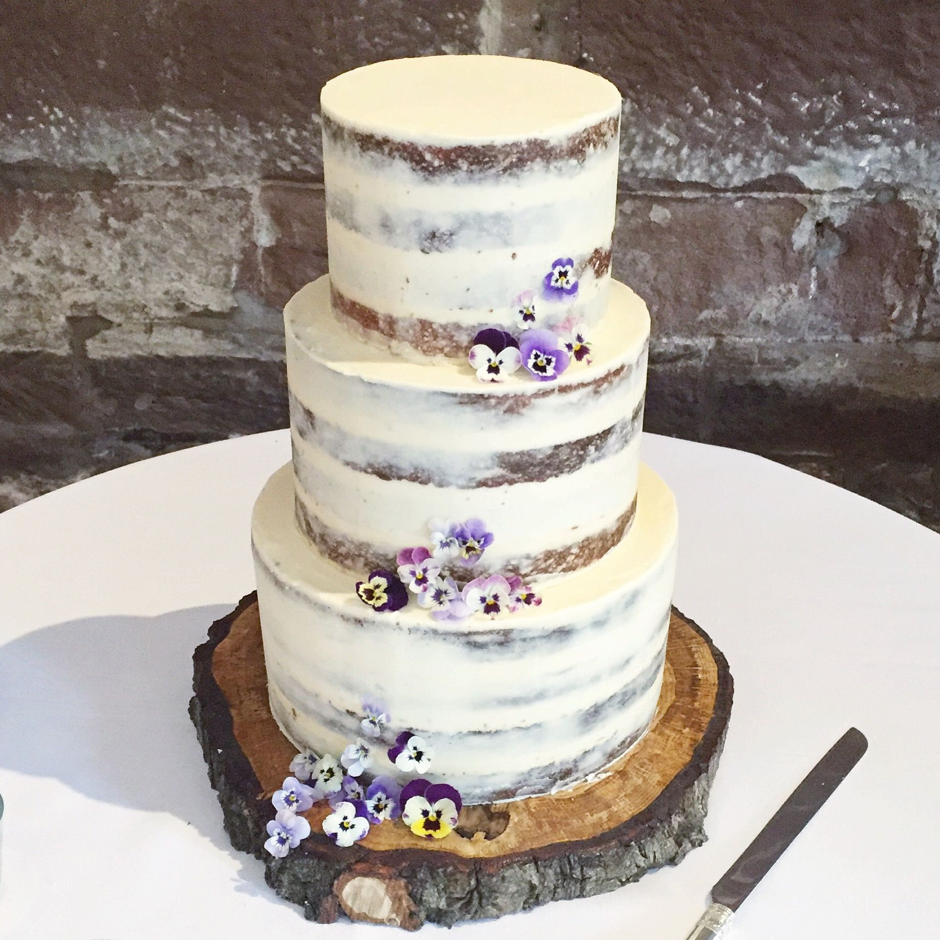 Semi naked buttercream wedding cake with edible flowers by Blossom ...