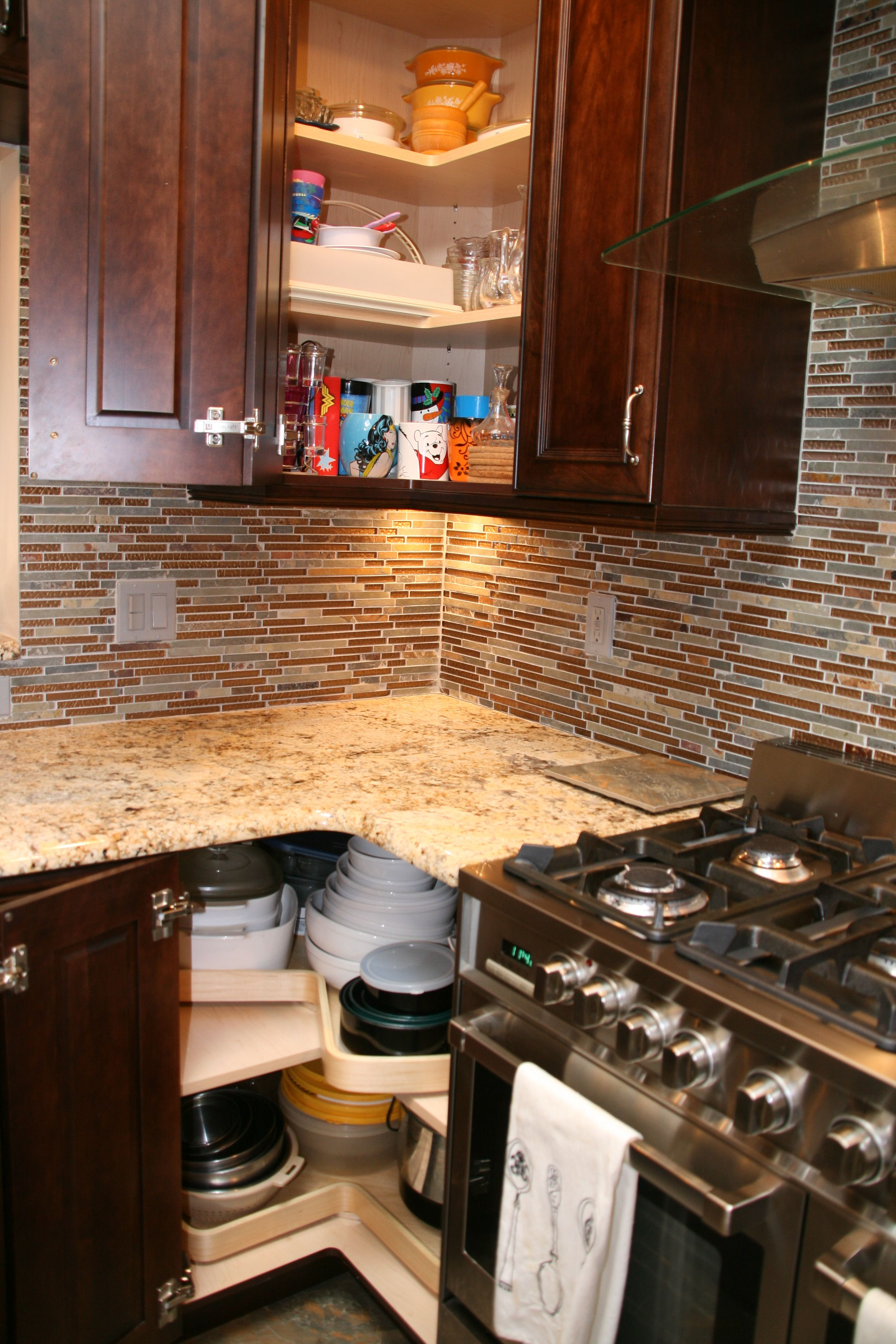 Effective Use Of Corner Spaces With Specialty Doors And Turntables Residential Remodel Corner Space Kitchen Cabinets