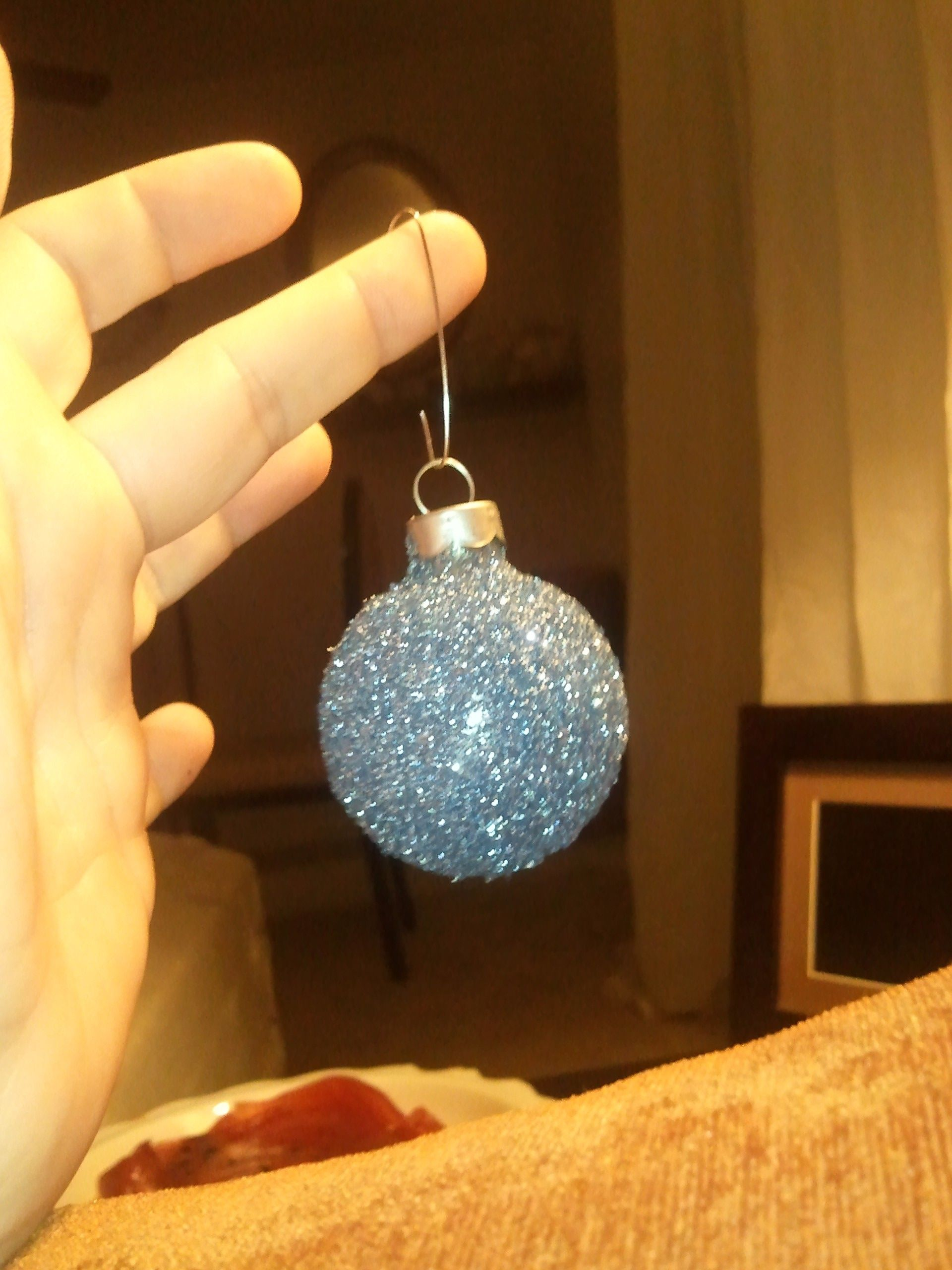 glittered ball ornaments. made by sprinkling glitter on