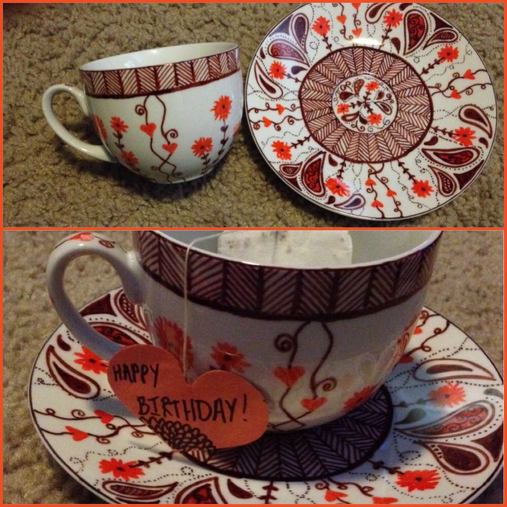 Tea cup and saucer I decorated for mom's bday.  I found a fired/glazed set at the hardware store and used sharpies to doodle on it.  Baked it in the oven at 350 for 20 min afterward.  Made personalized tea tags and included a dollar store travel mug to match. Cute bday/fall gift for those on a budget.