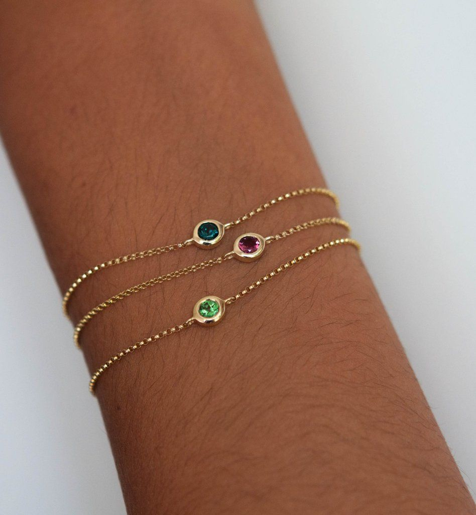 Oval hand bezeled gemstone bracelet in 14k solid gold. These delicate gemstone bracelet are hand crafted in our studio with beautiful Green Tsavorite, Pink Tourmaline or Blue Tourmaline. The bracelets