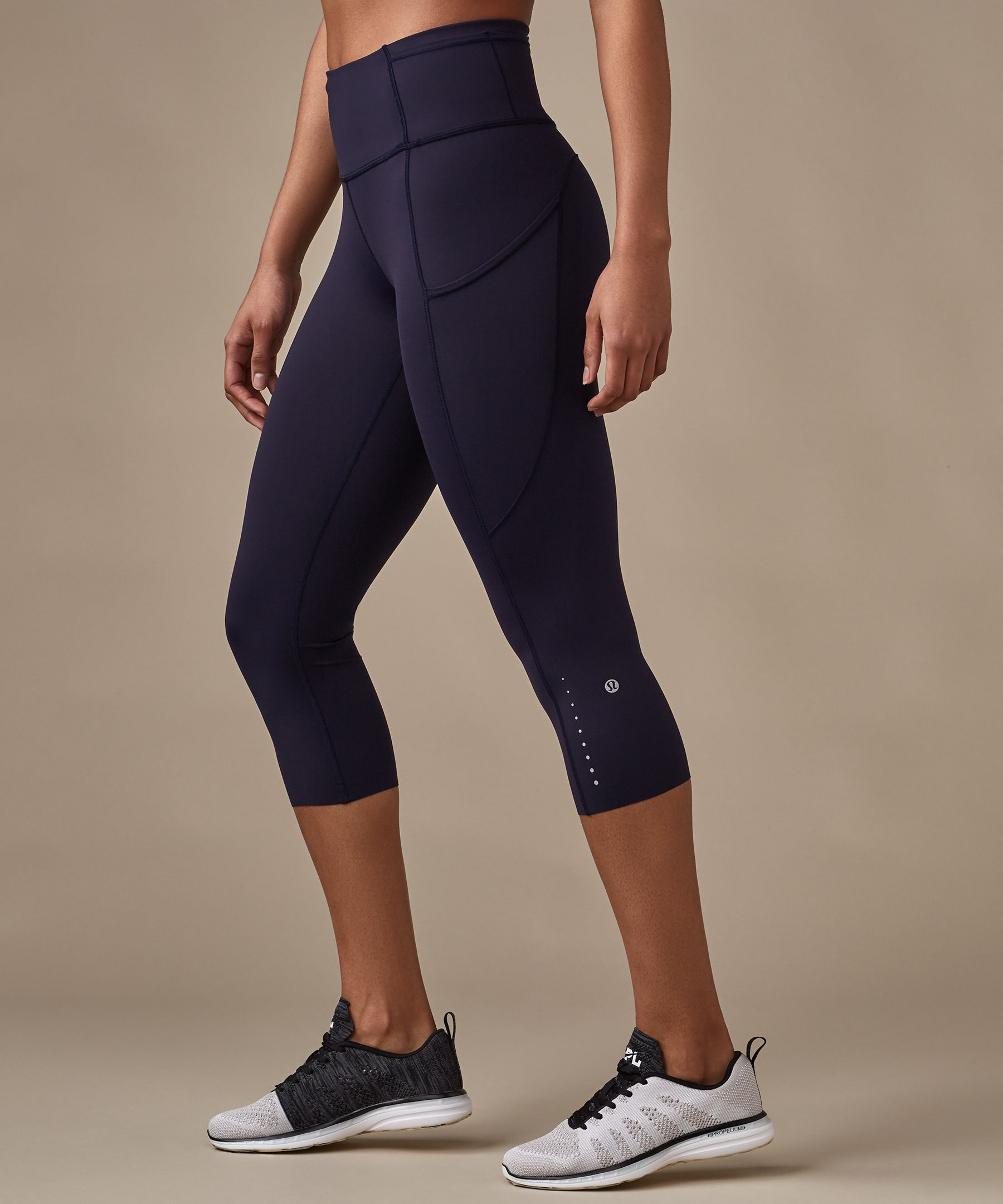 b4c92c517bd4b Feel fast and free in these barely there, sweat-wicking run crops. An  interior waist drawcord ensures the perfect fit, while reflective details  keep you ...