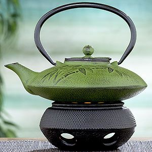 World Market - Green Cast Iron Teapot: Can't you just imagine pouring emerald hued tea from this?