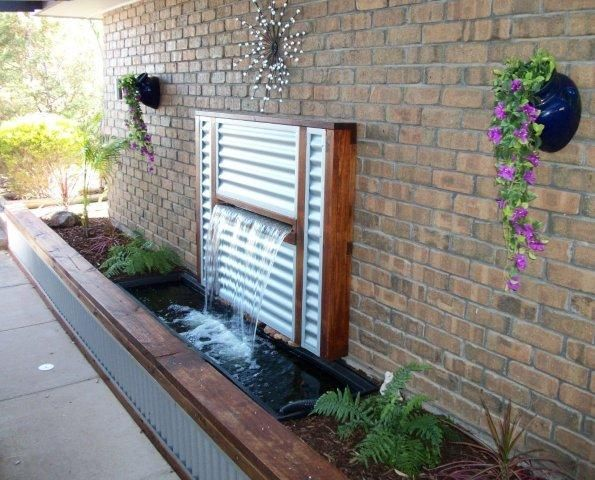 Water feature stainless steel spillway water blade for Outdoor feature wall ideas