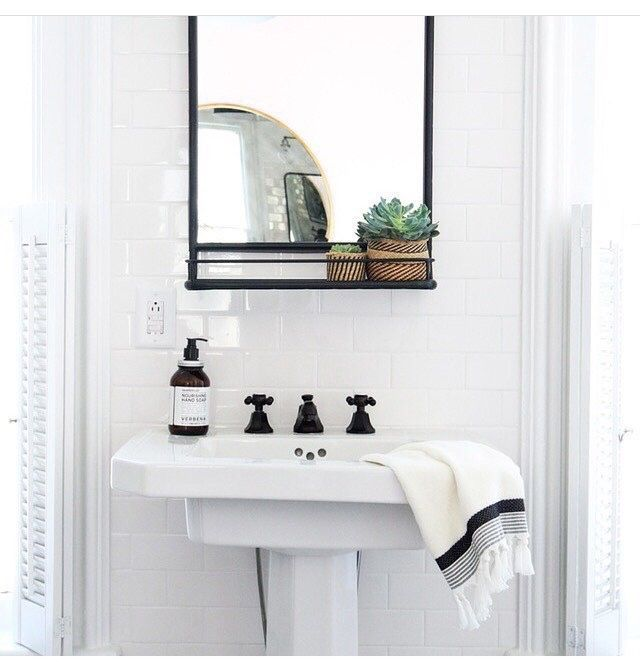 white bathroom with black classic accents
